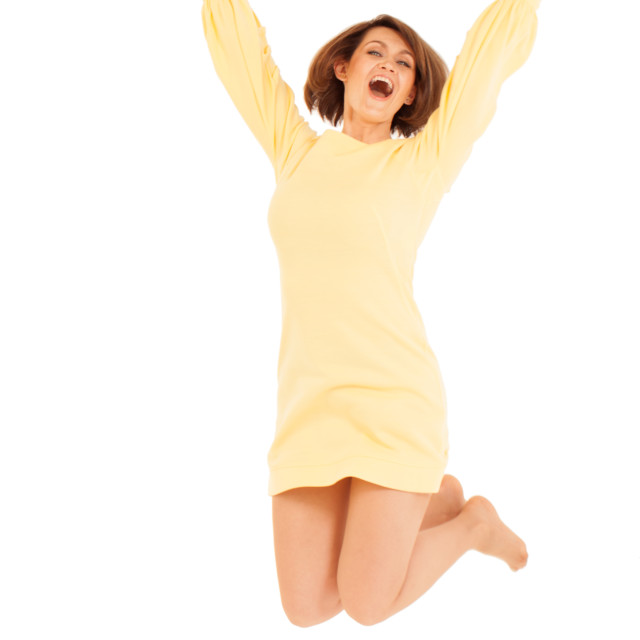 """""""Smiling adult woman jumping with hands up"""" stock image"""