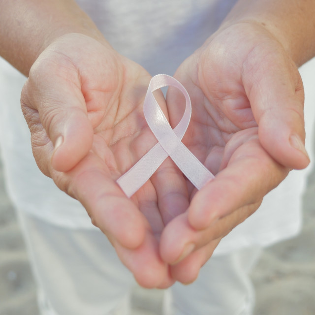 """""""Hands holding pink ribbon"""" stock image"""
