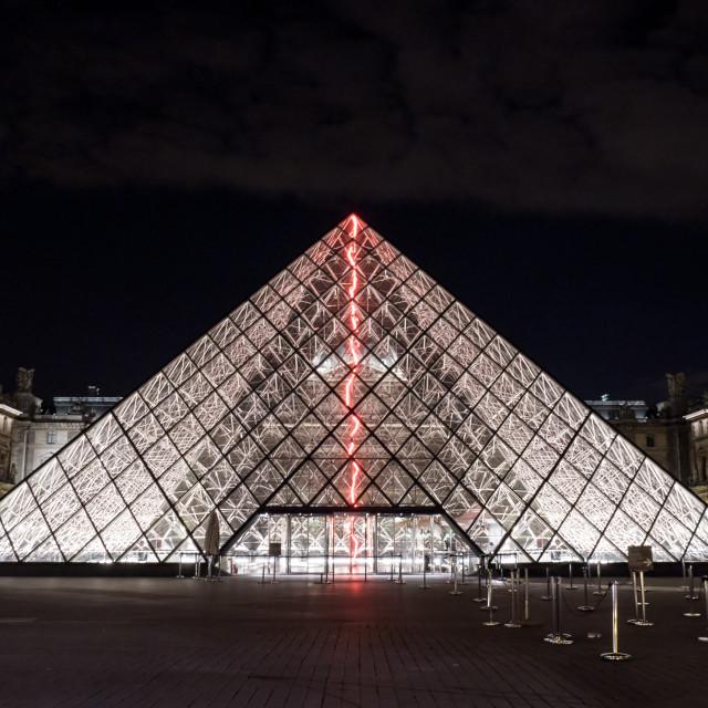 """Illuminated glass pyramid at the Louvre, Paris"" stock image"