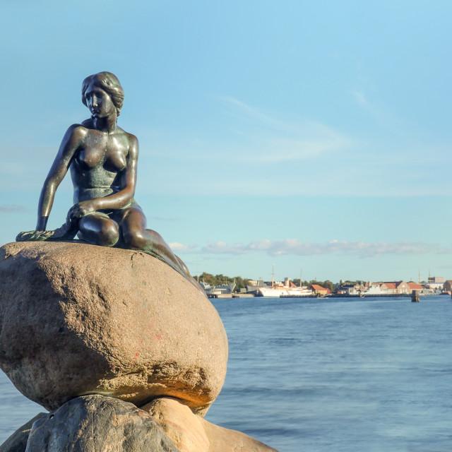 """Little Mermaid statue on rock in Denmark"" stock image"