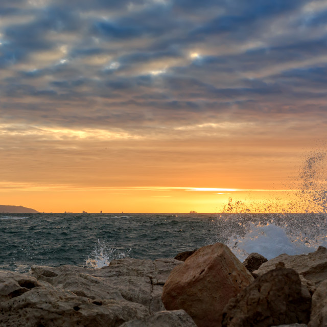 """""""A sunset viewed from the sea in Akko"""" stock image"""