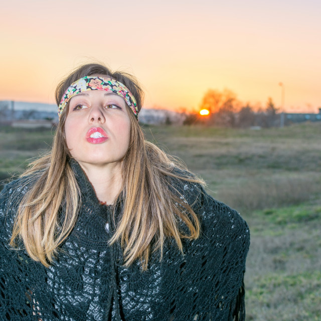 """Young hipster girl outdoors at sunset"" stock image"