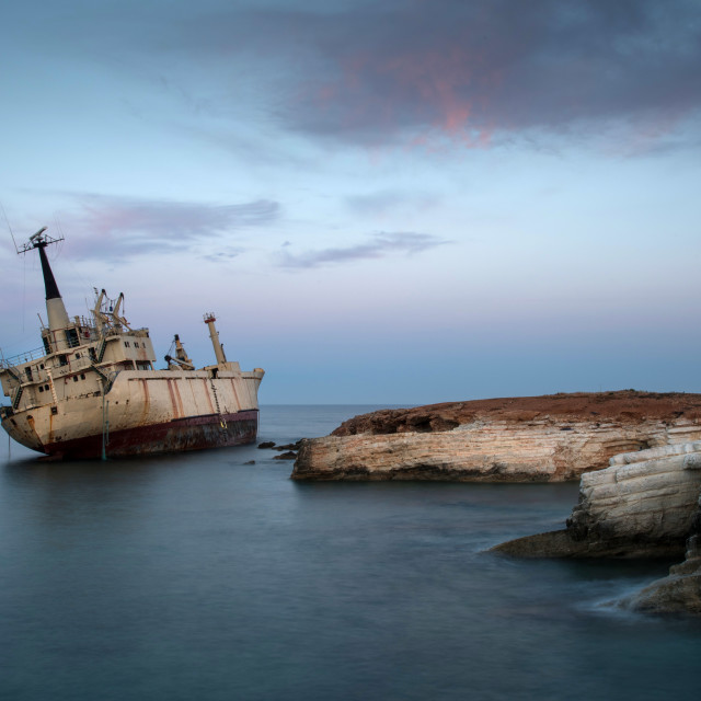 """Abandoned Ship on a rocky coast"" stock image"