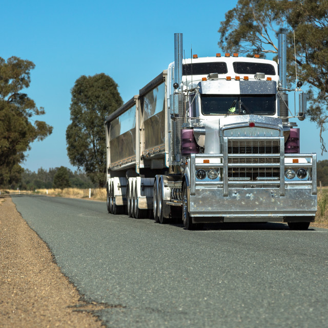 """Semi Trailer Road Transport on rural road"" stock image"