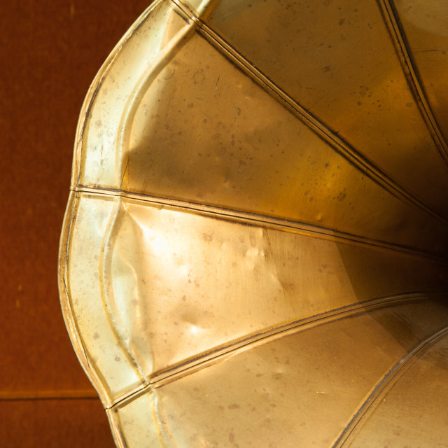 """""""Old gramophone horn detail on wooden background"""" stock image"""
