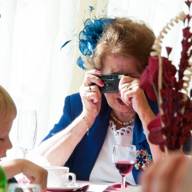 """""""Elderly lady taking photograph"""" stock image"""