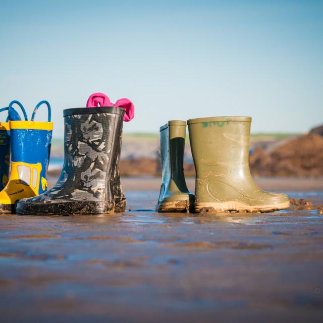 """Wellington boots on beach"" stock image"
