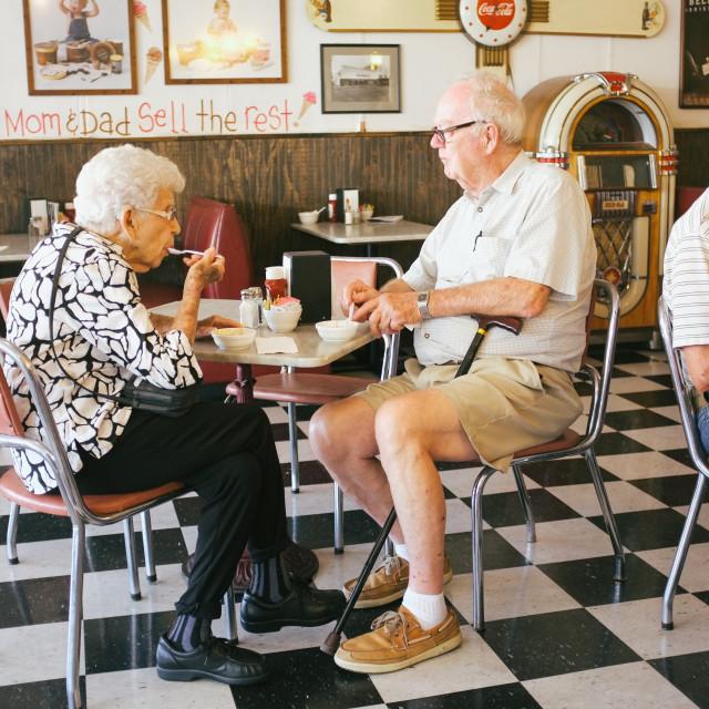 """Elderly couple Ice Cream Parlour"" stock image"