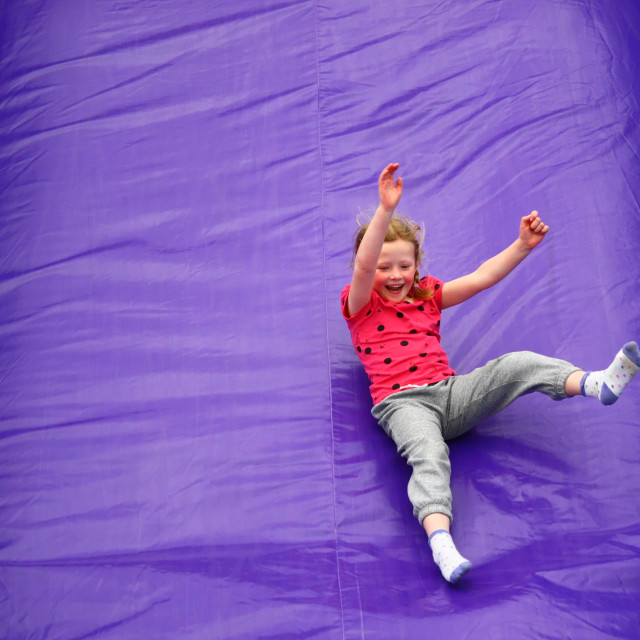 """Girl Having Fun on Slide"" stock image"