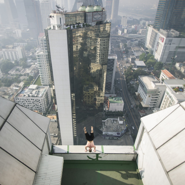 """Handstand on the edge of Bangkok"" stock image"