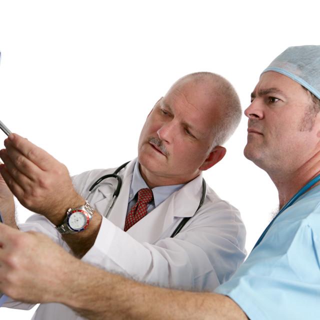 """""""Doctor & Intern Examining Xray"""" stock image"""