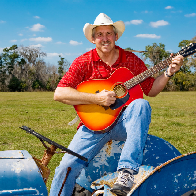 """Singing Cowboy Strums Guitar"" stock image"
