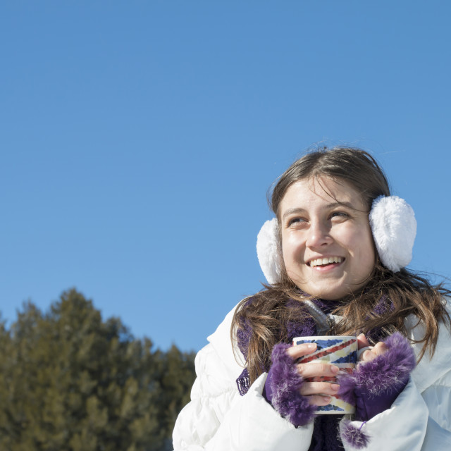 """Young girl with a cup of hot tea in winter"" stock image"