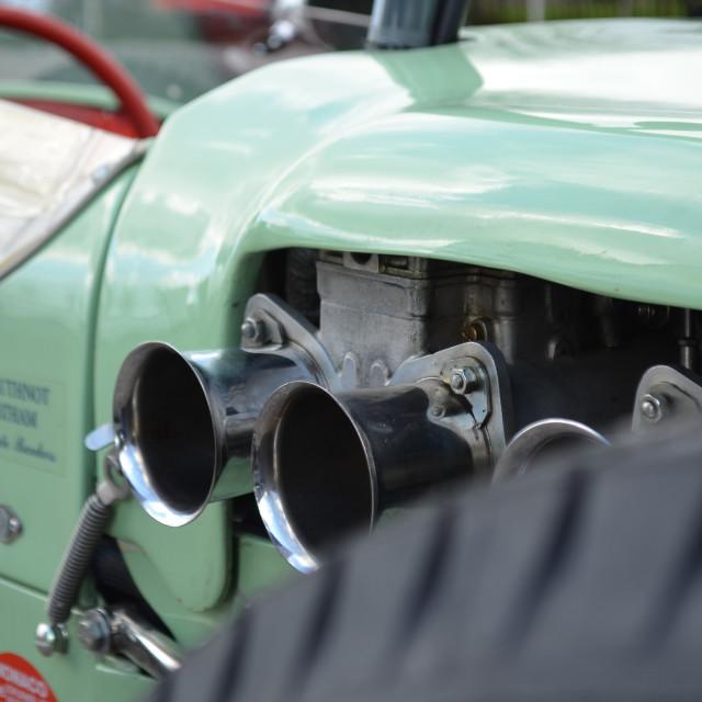 """Carburetors on a racing car."" stock image"