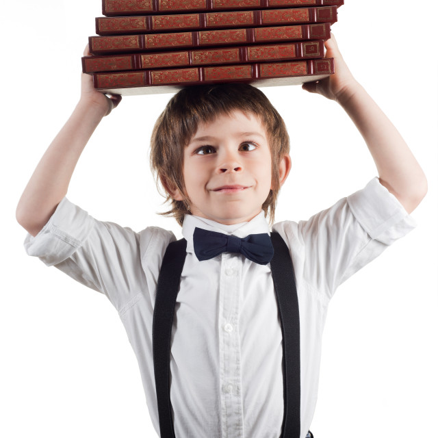 """Child and the weight of the books"" stock image"