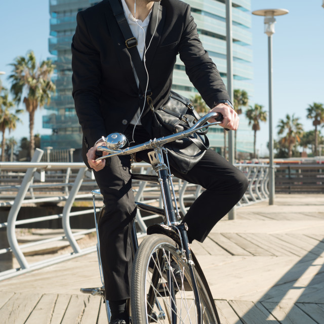 """young businessman in classical bike"" stock image"