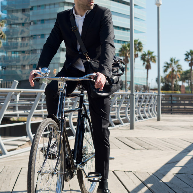 """businessman in vintage bike looking right"" stock image"