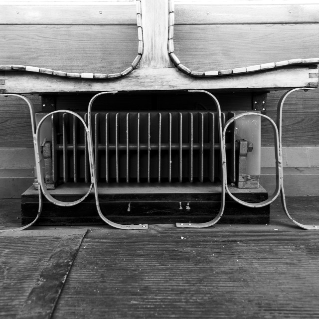 """Seats in antique tram in b&w"" stock image"