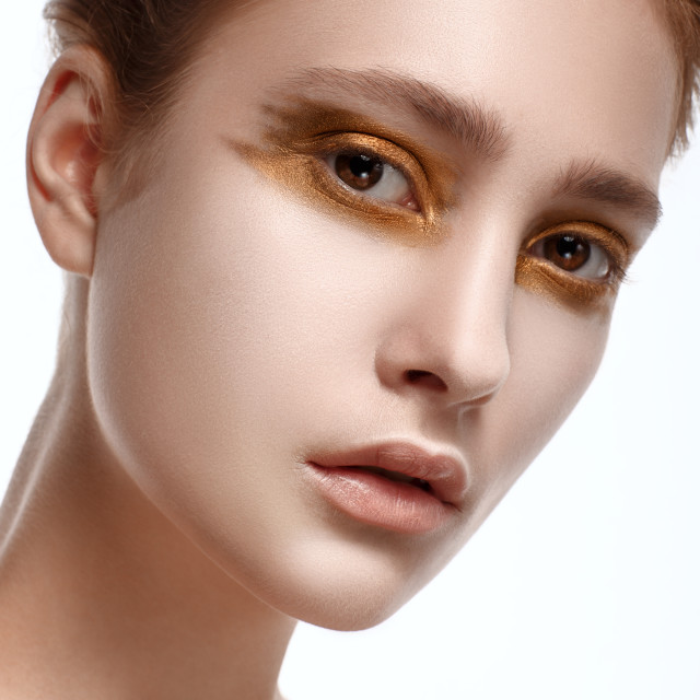 """""""Portrait of Beautiful Young Woman with bright golden perfect make-up"""" stock image"""