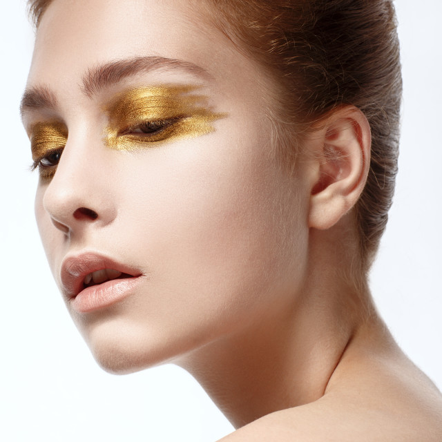 """""""Portrait of Beautiful Young Woman with bright golden make-up"""" stock image"""
