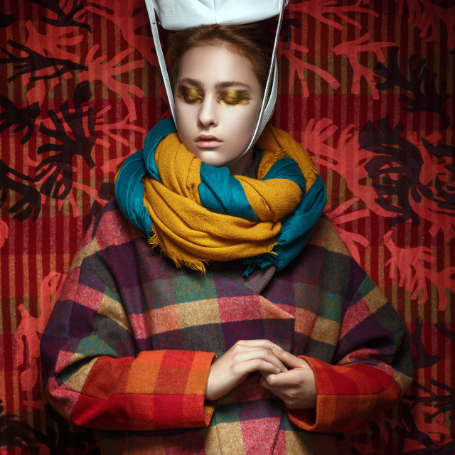 """""""Girl in autumn coat with scarf and hat on a bright colorful background"""" stock image"""