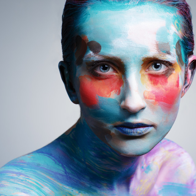 """""""Beautiful girl with creative colorful makeup on a gray background."""" stock image"""