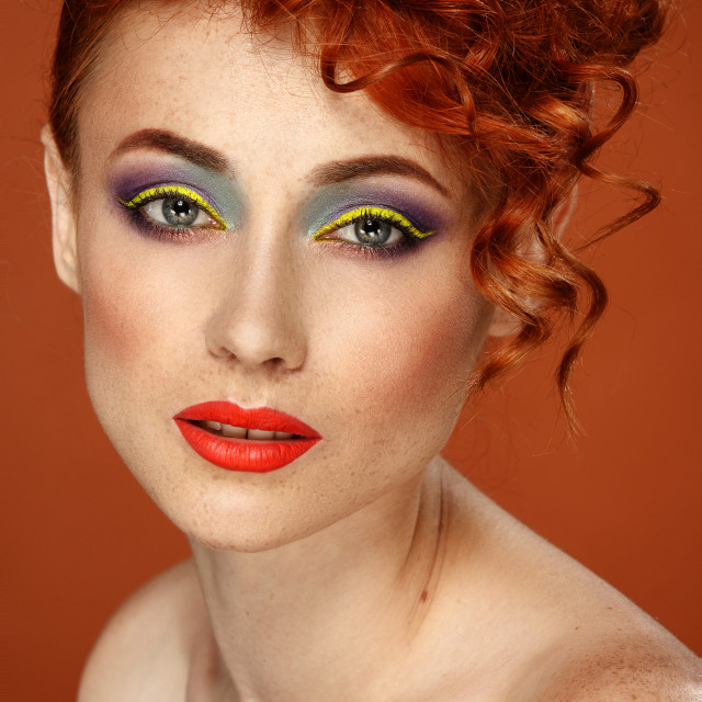 """""""Red-haired. Beautiful girl with bright makeup"""" stock image"""