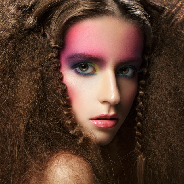 """""""Portrait of young woman with creative colorful make-up and hairstyle."""" stock image"""