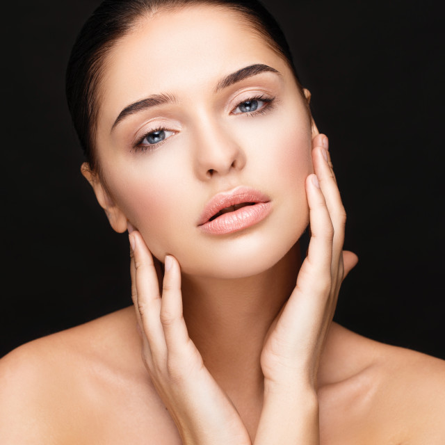 """""""Young woman touching her face. Beauty girl"""" stock image"""