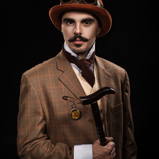 """""""Steampunk man in a hat and with a cane."""" stock image"""