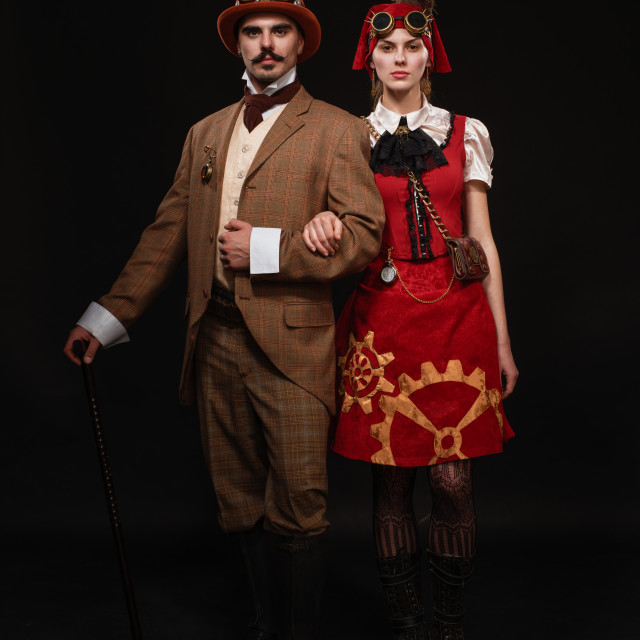 """""""The couple steampunk. A man with a cane and a girl with glasses"""" stock image"""