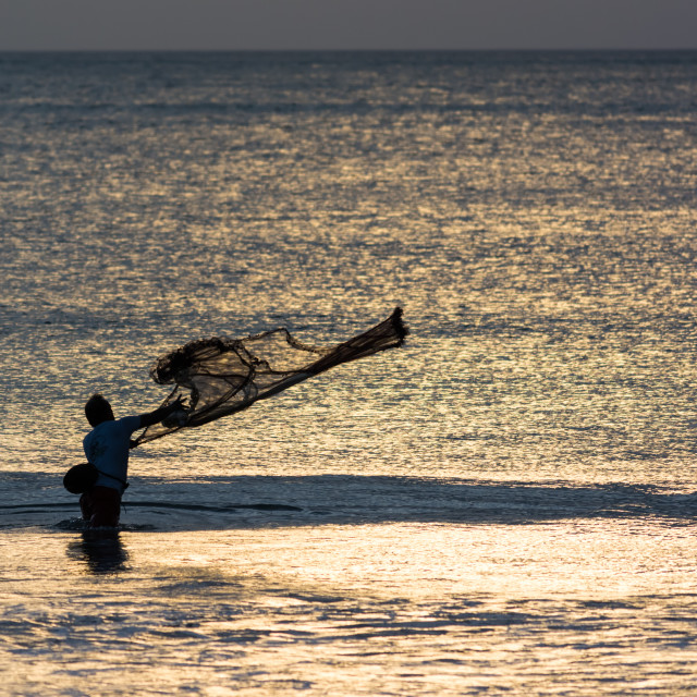 """Fishermen on Bali throws net"" stock image"