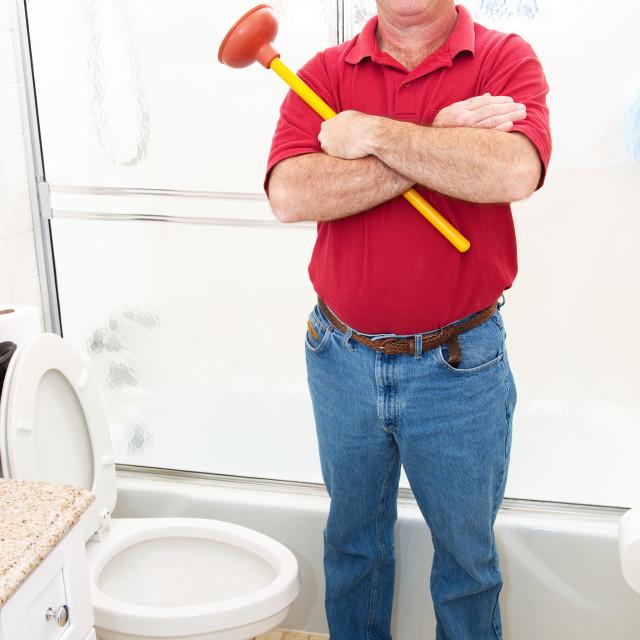 """Plumber in Bathroom"" stock image"