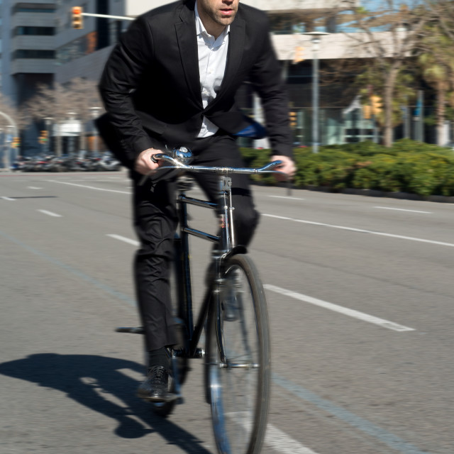"""""""fastest man cycling in the city"""" stock image"""
