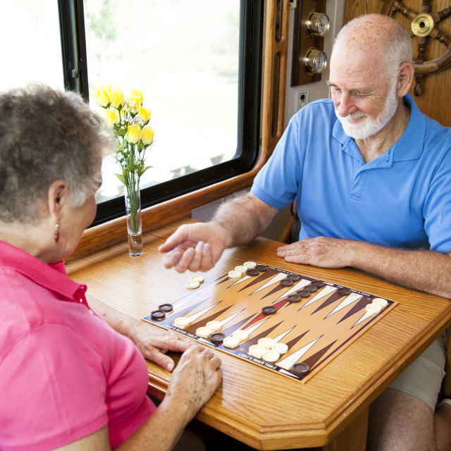 """RV Seniors Playing Board Game"" stock image"