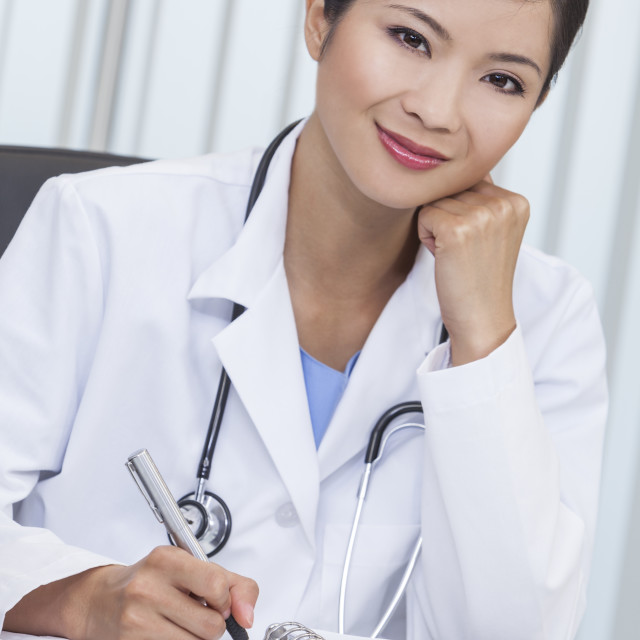 """""""Chinese Female Woman Hospital Doctor Writing In Office"""" stock image"""