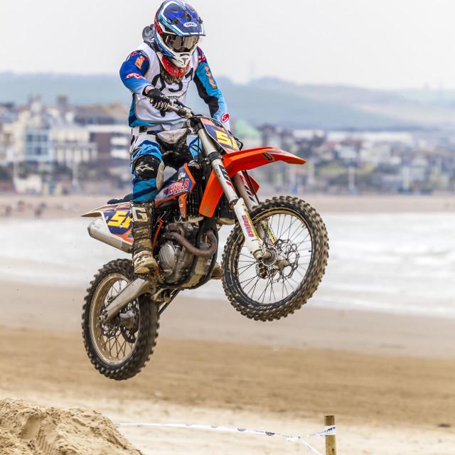"""""""A Biker Jumping a sand Dune"""" stock image"""