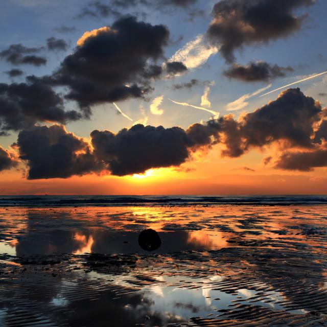 """Sunburst at dawn."" stock image"