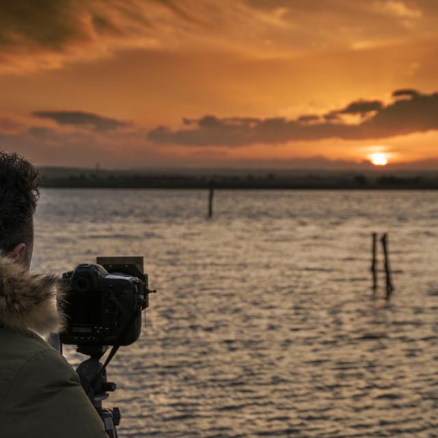 """Photographer at sunset"" stock image"