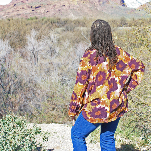 """""""Looking at red mountain."""" stock image"""