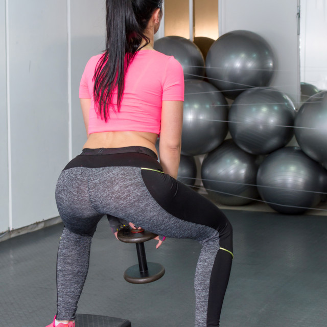 """""""girl doing squats with weights"""" stock image"""