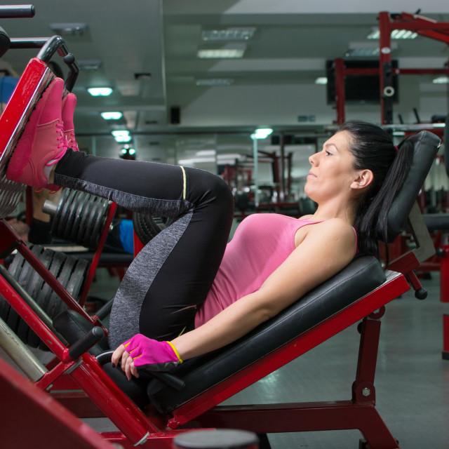 """""""Brunette doing the leg press"""" stock image"""