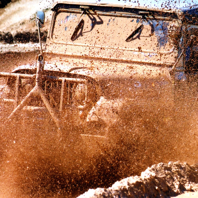 """A jeep in the mud"" stock image"