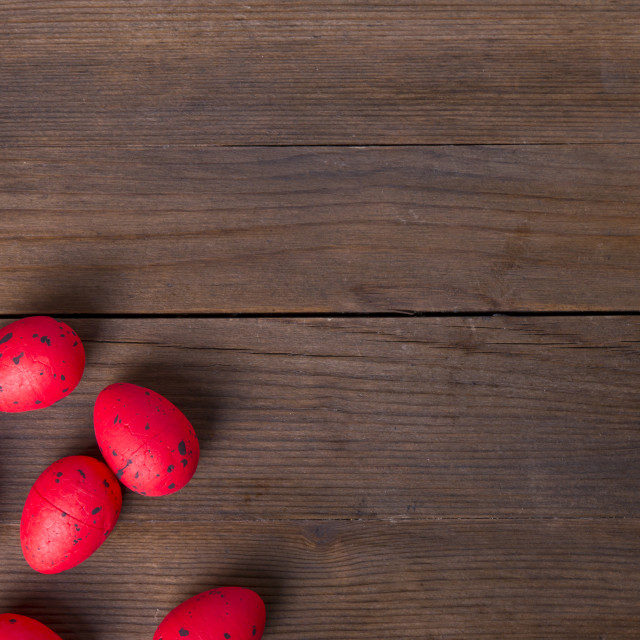 """Red Easter eggs on wooden background"" stock image"