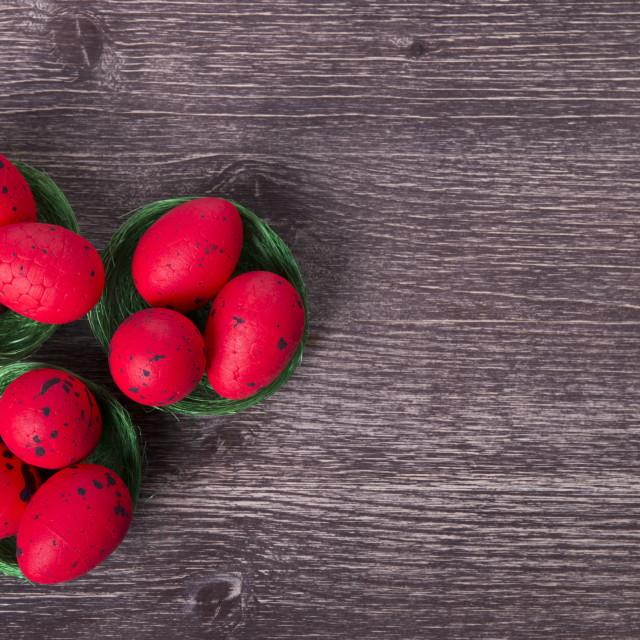 """Red Easter eggs on green nest"" stock image"