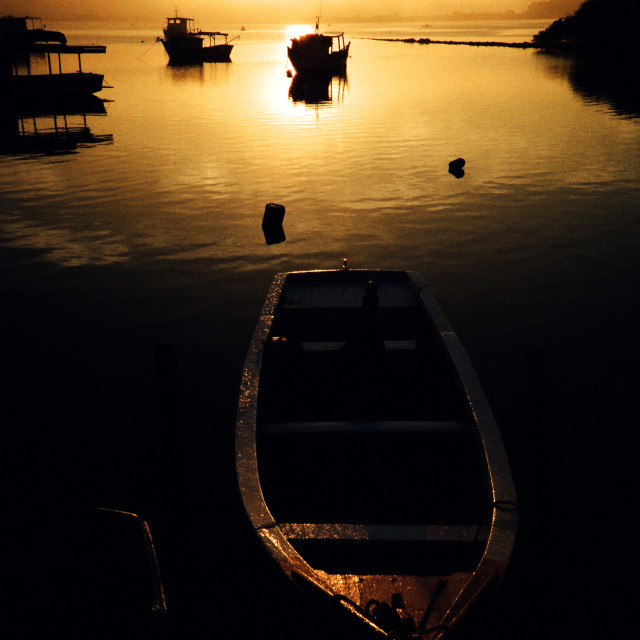 """The boats at the Sunrise"" stock image"