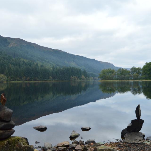 """Rock Balancing on Loch Chon"" stock image"