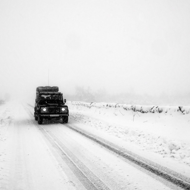 """Land Rover Defender in snow"" stock image"