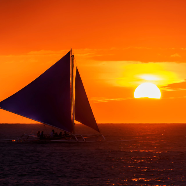 """Sunset sailing in the Philippines"" stock image"