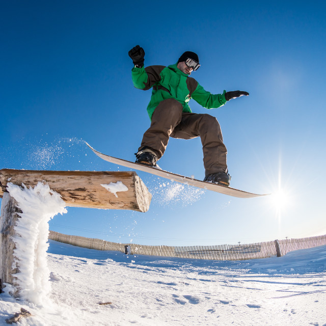 """""""Snowboarder jumping against blue sky"""" stock image"""